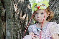 Portrait of girl 3_4 with face mask sitting on tree