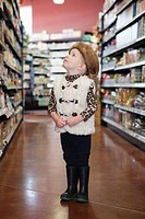 Boy 5_6 in costume standing in store