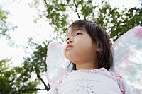 Portrait of cute baby girl 1-2 wearing costume with wings (thumbnail)