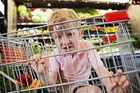 Boy 5_6 hiding inside of shopping card
