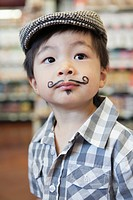 Portrait of boy 3_4 with fake moustache and goatee
