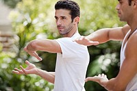 Man practicing yoga (thumbnail)