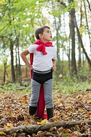 Boy 5_6 in costume standing in forest