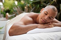 Man lying on massage table