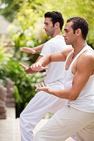 Two men practicing yoga