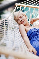 Portrait of woman relaxing in hammock