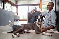 Man sitting on floor with his dog