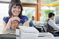 Portrait of smiling woman at desk
