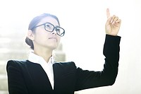 businesswoman pointing at the sky