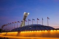 Olympic Stadium, designed by Architect Roger Taillibert, illuminated at dawn, Montreal, Quebec, Canada
