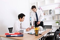 Two businessmen working in the office
