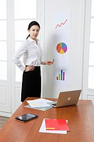Businesswoman pointing arrow graph