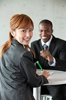 Businessman and businesswoman having meeting
