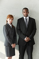 Businessman and businesswoman standing side by side