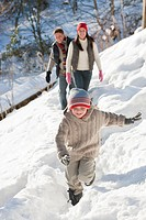 Family walking on snowy slope