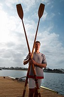 A portrait of a rower, oars and his double scull rowboat