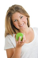 A beautiful smiling woman holding a green apple.