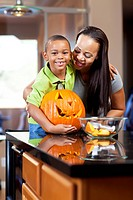 Mother and son carving jack_o_lantern