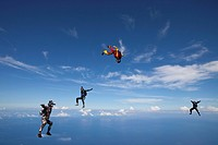 Four skydivers in the air