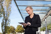 Germany, Bavaria, Munich, Businesswoman using digital tablet