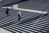 Germany, Bavaria, Munich, Engineers walking on stairs with briefcase