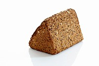 Multigrain rye bread loaf on white background, close up