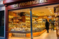 Paris, France, People Shopping in French Cheese Store, ´La Fromagerie´ on Montorgeuil Street, at Night