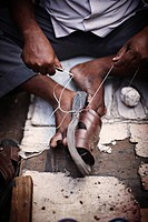 Close up of man repairing shoe