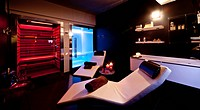 Chairs, bathtub and sauna in spa