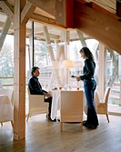Couple at breakfast in hotel´s on_site restaurant, Vigilius Mountain Resort, Vigiljoch, Lana, Trentino_Alto Adige/Suedtirol, Italy