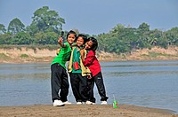 Three girls photographing themselves with a cell phone, Mekong River, Nong Khai, Thailand, Asia, PublicGround