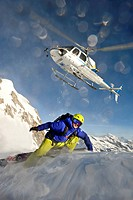 Helicopter and skier in the mountains, South Tyrol, Italy, Europe