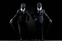 Businessmen with fencing masks and foils