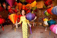 Woman inside a lampion store, Hoi An, Annma, Vietnam