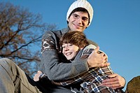 Germany, Bavaria, Father embracing son, smiling