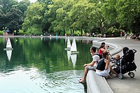 Visitors relax by the Lake in Central Park  Manhattan  New York City  USA.