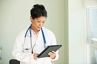 Asian doctor using digital tablet