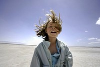 Smiling Young Girl With Hair Blowing in Wind, Salt Lake, Utah, USA