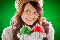 Mixed race woman holding Christmas ornaments