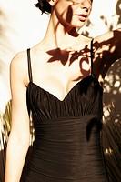 Glamorous Hispanic woman standing outdoors