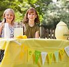 Caucasian girls with lemonade stand