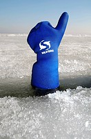 Diver's hand giving the Upwards sign, subglacial diving, ice diving, in the frozen Black Sea, a rare phenomenon, last time it occured in 1977, Odessa,...
