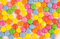 Lots of colorful smarties on white