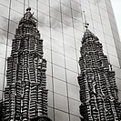 A reflection of the Petronas Towers in Kuala Lumpur, Malaysia