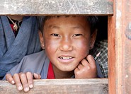 Young boy at his school in Ura Village, Ura Valley, Bumthang, Bhutan, Asia