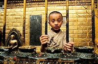Boy working as a priest in the Golden temple at Patan  Nepal  It´s a tradition among Newars, the original inhabitants of the Kathmandu valley  Every m...