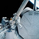 Astronauts Jeffrey Hoffman and S. David Griggs during extravehicular activity on the Space Shuttle Discovery, STS 51_D. Photograph, 1985.