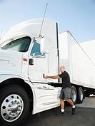 Truck driver entering truck