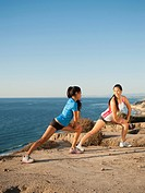 USA, California, San Diego, Two women stretching on beach