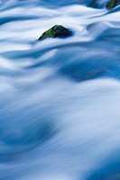 Flowing river, protruding rock